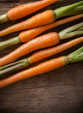 Carrots on a wooden background Royalty Free Stock Photos