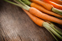 Carrots on a wooden background Royalty Free Stock Photo