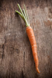 Carrots on a wooden background Royalty Free Stock Image
