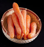 Carrots in wooden basket Stock Images