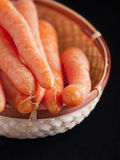 Carrots in wooden basket Stock Photography