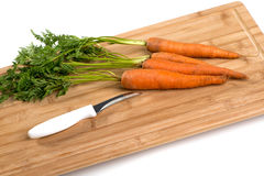Carrots on wooden board Stock Photo