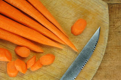Carrots on Wooden Cutting Board Stock Images