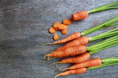 Carrots on wooden table. Stock Photos