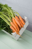 Carrots on wooden table Royalty Free Stock Photo