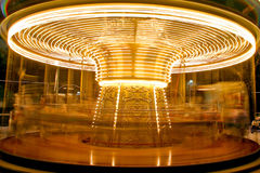 Carrousel. Carousel twisting fast in the night with thousands lights Stock Photography