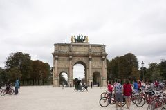 Carrousel Arc de Triomphe or Arc de Triomphe du Carrousel near Musee du Louvre in Paris, France. French people and foreigner travelers walking visit Carrousel Stock Photos