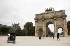 Carrousel Arc de Triomphe or Arc de Triomphe du Carrousel near Musee du Louvre in Paris, France. French people and foreigner travelers walking visit Carrousel Royalty Free Stock Photos