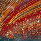 Carrousel avec le grand dos de brouillage de lumières Photographie stock