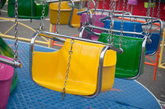 Carrousel chairs in attraction park. Closeup of carrousel chairs in attraction park Stock Photo