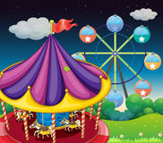 A carrousel with ferris wheel at the back. Illustration of a carrousel with ferris wheel at the back Royalty Free Stock Images