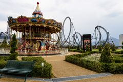 Carrousel merry go round, Fujikyu Highland. Yamanashi, Japan - May 01, 2017: carrousel merry go round in front of roller coaster railway at Gaspard et Lisa theme royalty free stock images