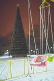 Carrousel in night winter park stock photos