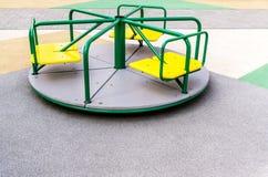 Carrousel op speelplaats stock fotografie