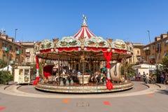 Carrousel sur la place Photos stock