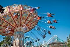 Carrousel sur le ciel bleu Photographie stock libre de droits