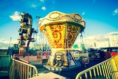 Carrousel uitstekende stijl in de stad Stock Foto