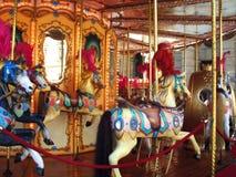 Carrousel vrolijk-gaan-rond Stock Afbeeldingen