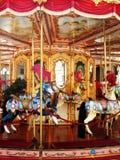 Carrousel vrolijk-gaan-rond Stock Foto's