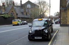Carrozza di tassì a Londra Immagine Stock Libera da Diritti