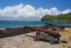 Carrs Bay in Montserrat. The cannons at Carrs Bay on the Caribbean island of Montserrat in the West Indies. Several cannons are aimed towards the smaller island Royalty Free Stock Photo