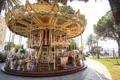 Carrusel en el parque de atracciones Azure Coast France September agradable 2017 Foto de archivo libre de regalías