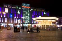 Carrusel en la noche en la Dnepropetrovsk cuadrada Fotos de archivo