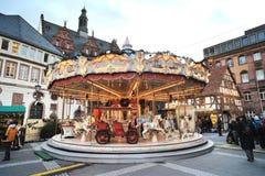 Carrusel en un mercado de la Navidad en d3ia Foto de archivo