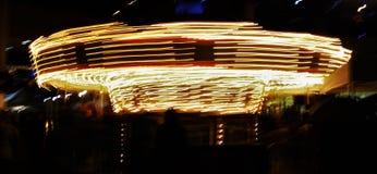 Carrusel encendido Foto de archivo libre de regalías