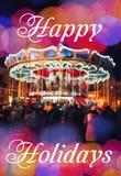 Carrusel francés con los caballos en la noche Saludo del Año Nuevo en fondo con el carrusel y el bokeh borrosos Feliz Navidad y N Foto de archivo libre de regalías
