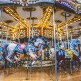 Carrusel francés viejo en un parque del día de fiesta Tres caballos y aeroplanos Fotografía de archivo libre de regalías