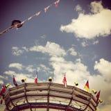 Carrusel y un cielo nublado Imágenes de archivo libres de regalías