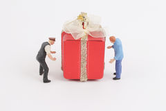 Carry the gift box with figure Royalty Free Stock Photos