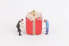 Carry the gift box with figure Royalty Free Stock Image