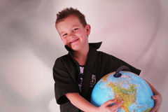 Carry the globe. Boy is holding the world in his arms Royalty Free Stock Image