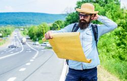Carry good map. Tourist backpacker looks at map choosing travel destination at road. Allow recognize enough details to. Walk somewhere if get lost. Around the royalty free stock photo