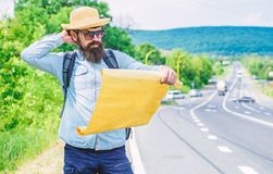 Carry good map. Tourist backpacker looks at map choosing travel destination at road. Allow recognize enough details to. Walk somewhere if get lost. Around the stock photography
