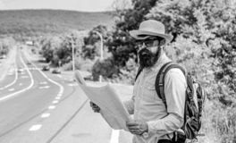 Carry good map. Tourist backpacker looks at map choosing travel destination at road. Around the world. Find map large. Sheet of paper. Allow recognize enough stock image