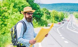 Carry good map. Tourist backpacker looks at map choosing travel destination at road. Around the world. Find map large. Sheet of paper. Allow recognize enough royalty free stock photos