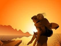 Carry my lover. Man carry his girlfriend in back Stock Photo