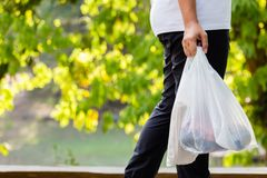 Carry Plastic Bags no parque imagem de stock royalty free