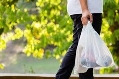 Carry Plastic Bags no parque imagem de stock royalty free