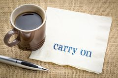 Carry on - text on napkin. Carry on encouragement - handwriting on a napkin with a cup of coffee stock photos