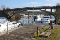 Carrybridge, Upper Lough Erne, river cruisers. Carrybridge, river cruisers and road bridge, Upper Lough Erne, Co Fermanagh, Northern Ireland. Jetty with railings Royalty Free Stock Photography