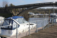Carrybridge, Upper Lough Erne, river cruisers. Carrybridge, river cruisers and road bridge, Upper Lough Erne, Co Fermanagh, Northern Ireland. Jetty with railings Stock Image
