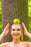 Carrying apple on head. Royalty Free Stock Photography