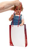 Carrying baby in paper bag Stock Images
