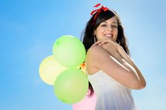 Carrying Balloons Smiling Royalty Free Stock Image