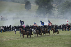 Carrying the battle flags. A long line of Union Cavalry soldiers  on the battlefield at the 150th anniversary of the battle of Gettysburg, Pennsylvania Stock Images