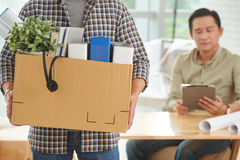 Carrying belongings. Cropped image of employee with box of belongings Royalty Free Stock Image